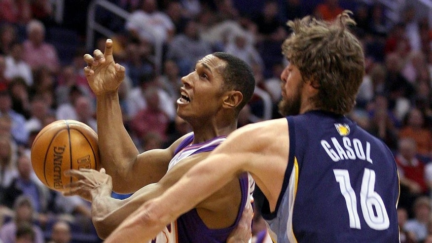 FILE - In this Feb. 8, 2006, file photo, Phoenix Suns forward Boris Diaw, left, of France, loses control of the ball as Memphis Grizzlies center Pau Gasol, of Spain, swats it away during an NBA basketball game in Phoenix. Gasol was called for a foul on the play. (AP Photo/Paul Connors, File)