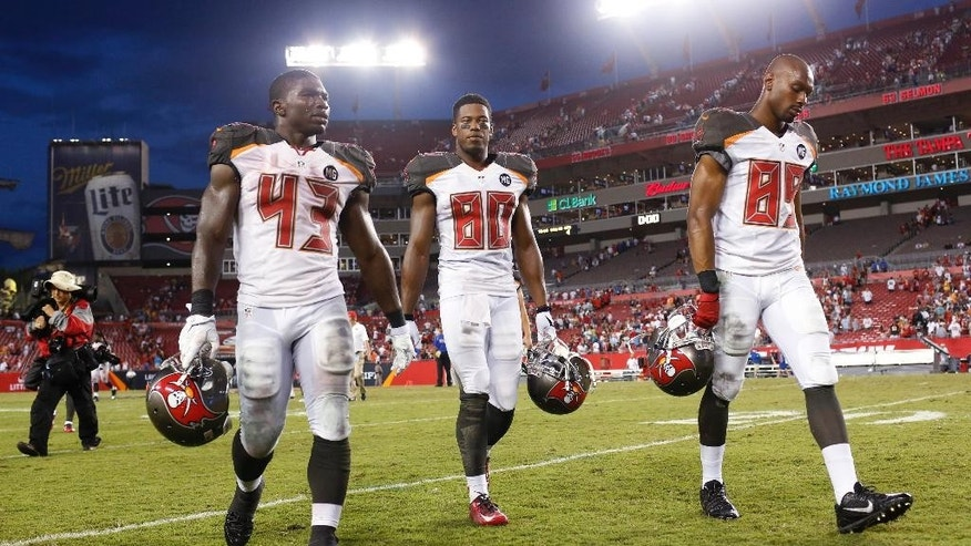 Tampa Bay Buccaneers running back Bobby Rainey (43), wide receiver Chris Owusu (80) and wide receiver Russell Shepard (89) leave the field after Tampa Bay lost to the St. Louis Rams, 19-17, during an NFL football game Sunday, Sept. 14, 2014, in Tampa, Fla. (AP Photo/Brian Blanco)