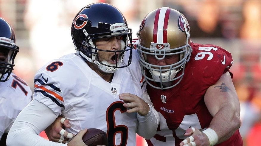 San Francisco 49ers defensive tackle Justin Smith (94) sacks Chicago Bears quarterback Jay Cutler (6) during the second quarter of an NFL football game in Santa Clara, Calif., Sunday, Sept. 14, 2014. (AP Photo/Marcio Jose Sanchez)