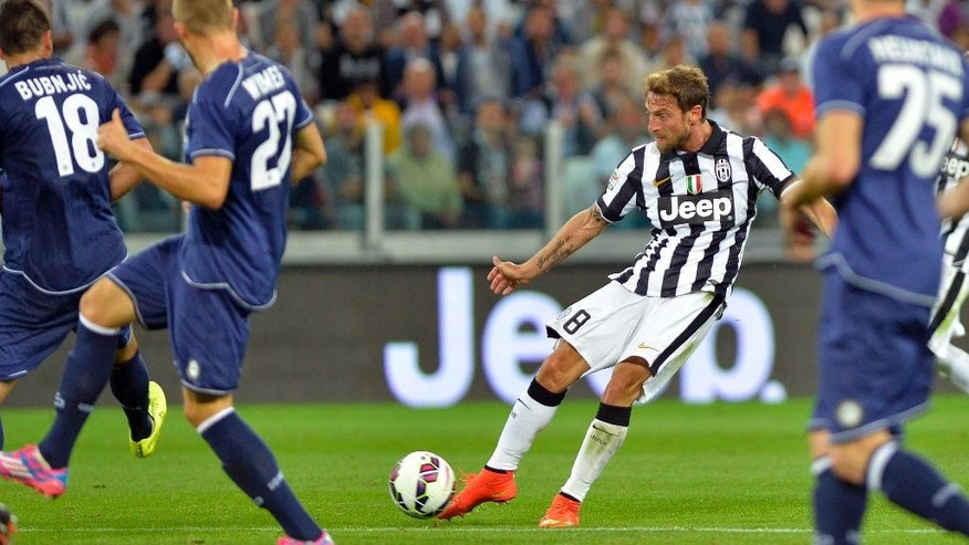 Juventus' Claudio Marchisio scores his side's second goal, during a Serie A soccer match between Juventus and Udinese at the Juventus stadium, in Turin, Italy, Saturday, Sept. 13, 2014. (AP Photo/Massimo Pinca)