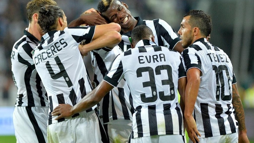 Juventus players celebrate after Claudio Marchisio scored his side's second goal during a Serie A soccer match between Juventus and Udinese at the Juventus stadium, in Turin, Italy, Saturday, Sept. 13, 2014. (AP Photo/Massimo Pinca)