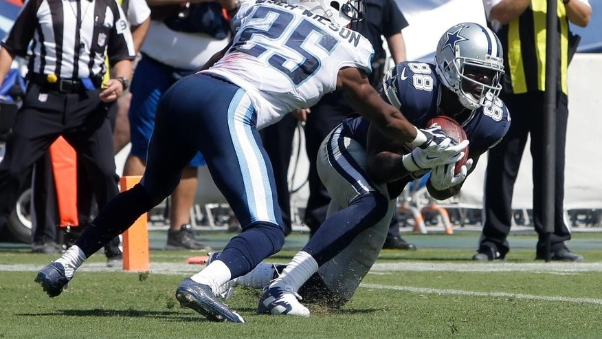 Dallas Cowboys wide receiver Dez Bryant (88) catches a touchdown pass as he is defended by Tennessee Titans cornerback Blidi Wreh-Wilson (25) on a 3-yard pass play in the third quarter of an NFL football game Sunday, Sept. 14, 2014, in Nashville, Tenn. (AP Photo/Wade Payne)