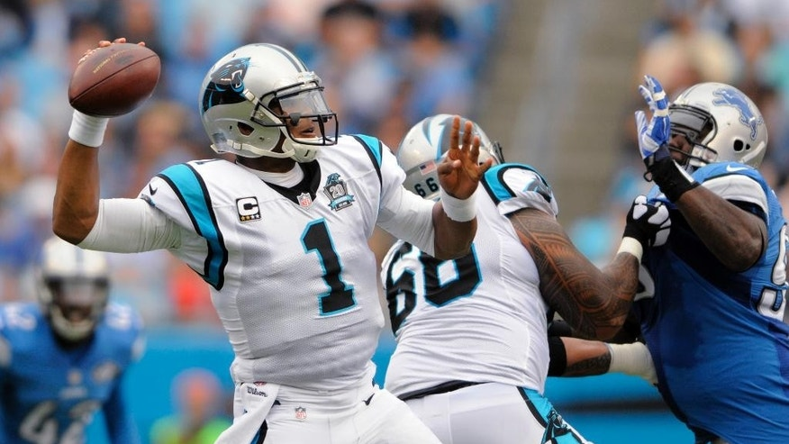 Carolina Panthers' Cam Newton (1) looks to pass against the Detroit Lions during the first half of an NFL football game in Charlotte, N.C., Sunday, Sept. 14, 2014. (AP Photo/Mike McCarn)