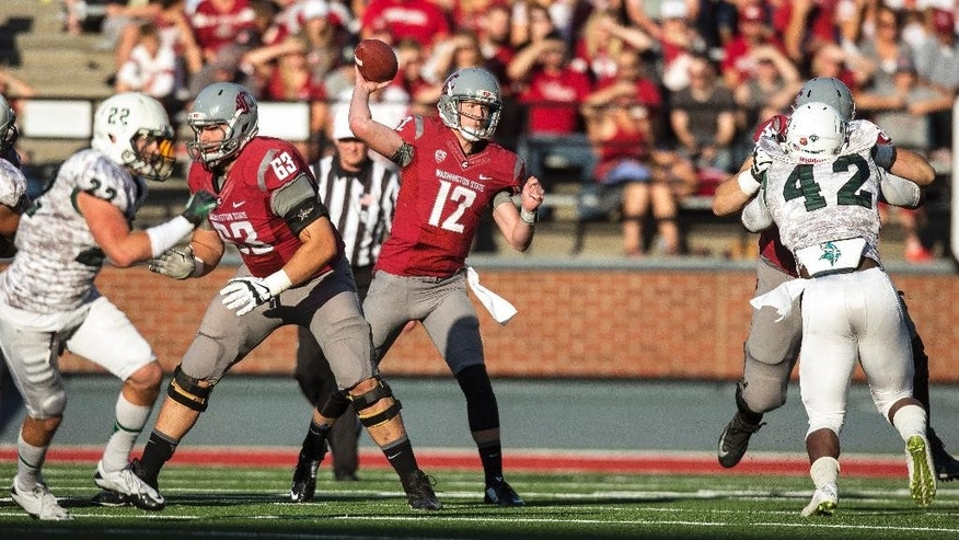 Washington State quarterback Connor Halliday (12) attempts a pass against Portland State while protected by left guard Gunnar Eklund (63) during the first half of an NCAA college football game Saturday, Sept. 13, 2014, at Martin Stadium in Pullman, Wash. (AP Photo/Dean Hare)