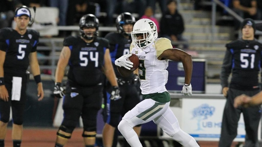 Baylor wide receiver KD Cannon (9) runs after a catch for a touchdown during the first half of an NCAA college football game against Buffalo on Friday, Sept. 12, 2014, in Amherst, N.Y. (AP Photo/Bill Wippert)