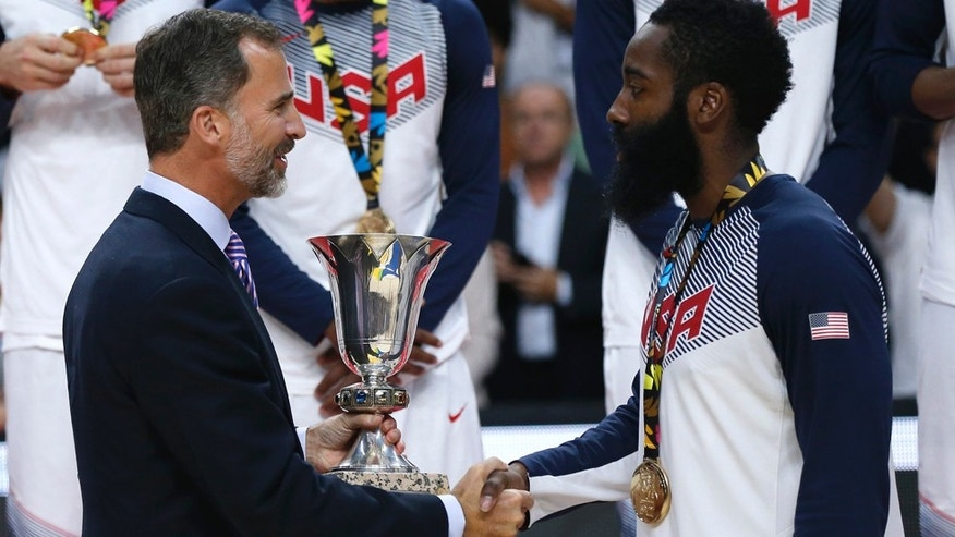 United States' James Harden shakes hands with Spain's King Felipe after winning the final World Basketball match between the United States and Serbia at the Palacio de los Deportes stadium in Madrid, Spain, Sunday, Sept. 14, 2014. (AP Photo/Daniel Ochoa de Olza)