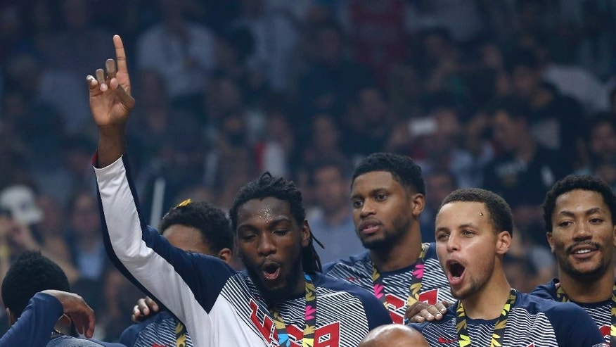 United States' players celebrate after wining the final World Basketball match against Serbia at the Palacio de los Deportes stadium in Madrid, Spain, Sunday, Sept. 14, 2014. (AP Photo/Daniel Ochoa de Olza)