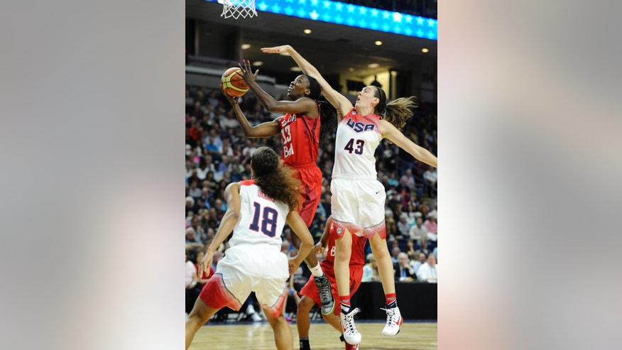 Canada's Tamara Tatham reaches up to the basket as USA's Skylar Diggins, left, and Breanna Stewart, right, defend, during the first half of an women's exhibition basketball game, Monday, Sept. 15, 2014, in Bridgeport, Conn. (AP Photo/Jessica Hill)