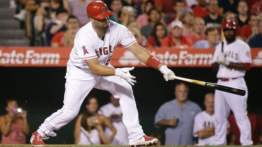 Los Angeles Angels' Albert Pujols hits a three-run double during the third inning of a baseball game against the Seattle Mariners Monday, Sept. 15, 2014, in Anaheim, Calif. (AP Photo/Jae C. Hong)