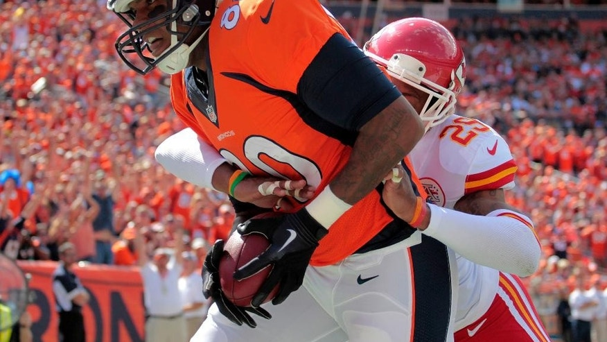 Denver Broncos strong safety T.J. Ward (43) celebrates a fourth-down stop against the Kansas City Chiefs in the closing seconds of an NFL football game, Sunday, Sept. 14, 2014, in Denver. The Broncos won 24-17. (AP Photo/Jack Dempsey)