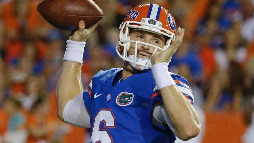 Florida quarterback Jeff Driskel (6) throws a pass against Kentucky during the first half of an NCAA college football game in Gainesville, Fla., Saturday, Sept. 13, 2014. (AP Photo/John Raoux)