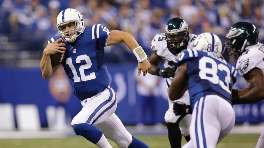 Indianapolis Colts quarterback Andrew Luck (12) runs during the second half of an NFL football game against the Philadelphia Eagles Monday, Sept. 15, 2014, in Indianapolis. (AP Photo/AJ Mast)