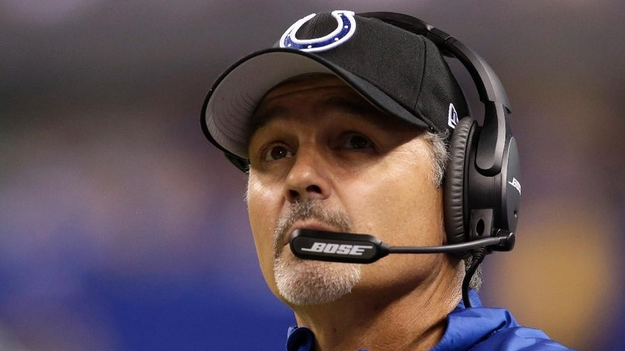 Indianapolis Colts head coach Chuck Pagano watches a replay during the first half of an NFL football game against the Philadelphia Eagles Monday, Sept. 15, 2014, in Indianapolis. (AP Photo/AJ Mast)
