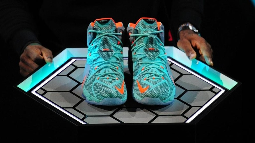 LeBron James introduces the LeBron 12 shoe at the Nike World Headquarters in Beaverton, Ore.,Tuesday, Sept. 16, 2014. (AP Photo/Steve Dykes)