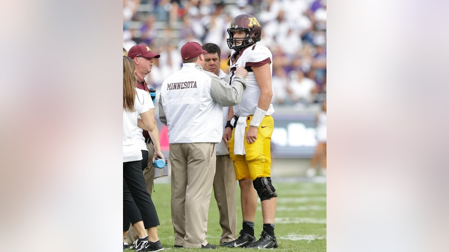 Minnesota quarterback Mitch Leidner (7) leaves the game after taking a hard hit during the second half of an NCAA college football game against TCU, Saturday, Sept. 13, 2014, in Fort Worth, Texas.  TCU won 30-7. (AP Photo/LM Otero)