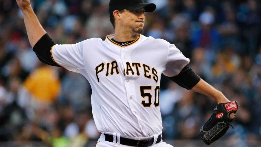 Pittsburgh Pirates starting pitcher Charlie Morton delivers during the first inning of a baseball game against the Boston Red Sox in Pittsburgh Tuesday, Sept. 16, 2014. (AP Photo/Gene J. Puskar)