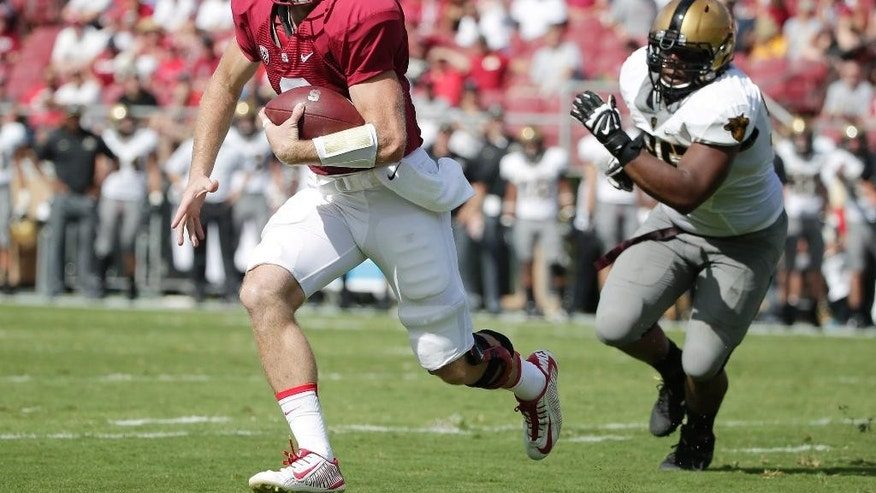 Stanford quarterback Kevin Hogan, left, is chased by Army defensive lineman Richard Glover during the first half of an NCAA college football game on Saturday, Sept. 13, 2014, in Stanford, Calif. (AP Photo/Marcio Jose Sanchez)