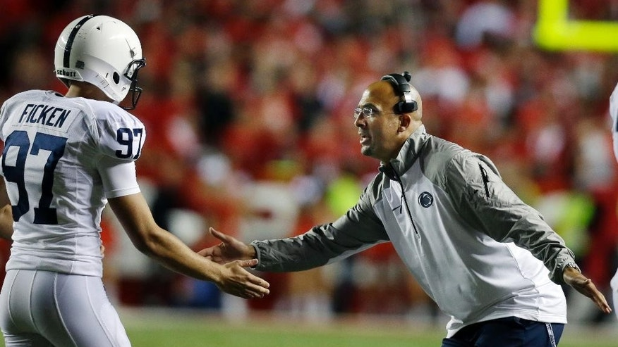 Penn State coach James Franklin congratulates kicker Sam Ficken (97) late in the fourth quarter of an NCAA college football game against Rutgers on Saturday, Sept. 13, 2014, in Piscataway, N.J. Penn State won 13-10. (AP Photo/Mel Evans)