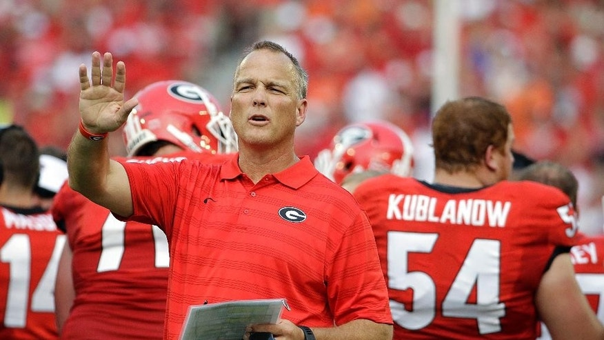 "FILE - In this Aug. 30, 2014, file photo, Georgia head coach Mark Richt calls out from the sideline during the first half of an NCAA college football game against Clemson in Athens, Ga. Georgia's Richt, Tennessee's Butch Jones, Washington's Chris Petersen and Clemson's Dabo Swinney are among the coaches who have adopted ""The Energy Bus,"" a book that extols the power of positive thinking and warns to stay away from ""energy vampires."" (AP Photo/David Goldman, File)"