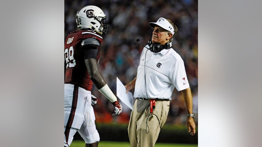 South Carolina head coach Steve Spurrier, right, talks with tight end Jerell Adams (89) during the second half of an NCAA college football game on Saturday, Sept. 13, 2014, in Columbia, S.C. (AP Photo/Rainier Ehrhardt)