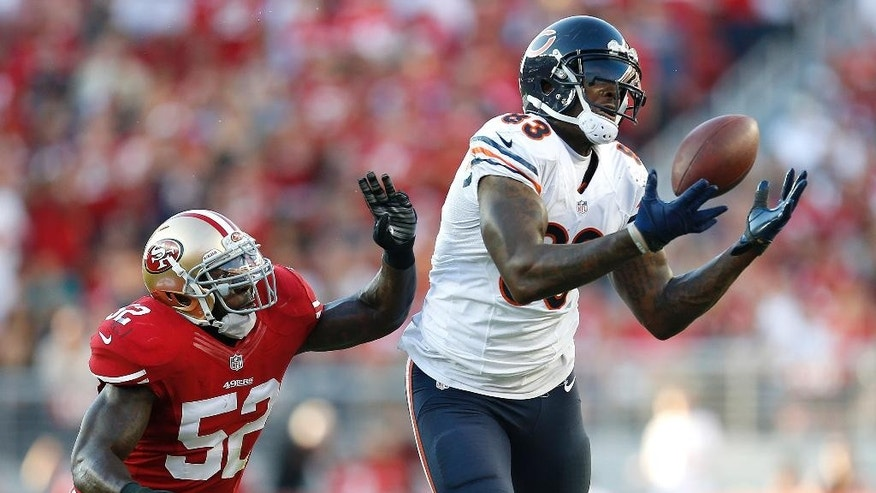 Chicago Bears tight end Martellus Bennett (83) cannot catch a pass in front of San Francisco 49ers linebacker Patrick Willis (52) during the second quarter of an NFL football game in Santa Clara, Calif., Sunday, Sept. 14, 2014. (AP Photo/Tony Avelar)