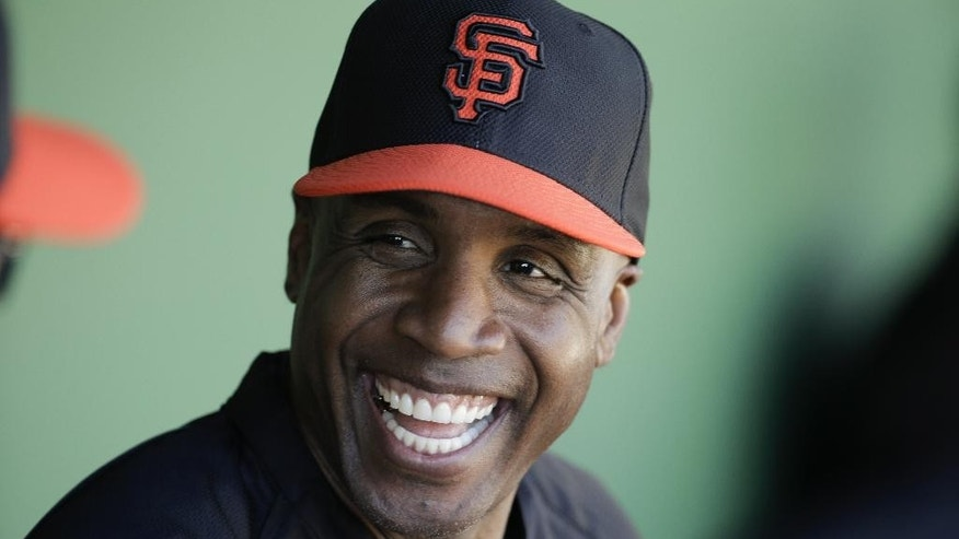 FILE - In this March 10, 2014, file photo, former San Francisco Giants Barry Bonds chats to the dugout during a spring training baseball game in Scottsdale, Ariz. Bonds gets another attempt to overturn his obstruction of justice conviction when an 11-judge panel of the 9th U.S. Circuit Court of Appeals hears arguments in his case Thursday, Sept. 18, 2014.  (AP Photo/Chris Carlson, File)