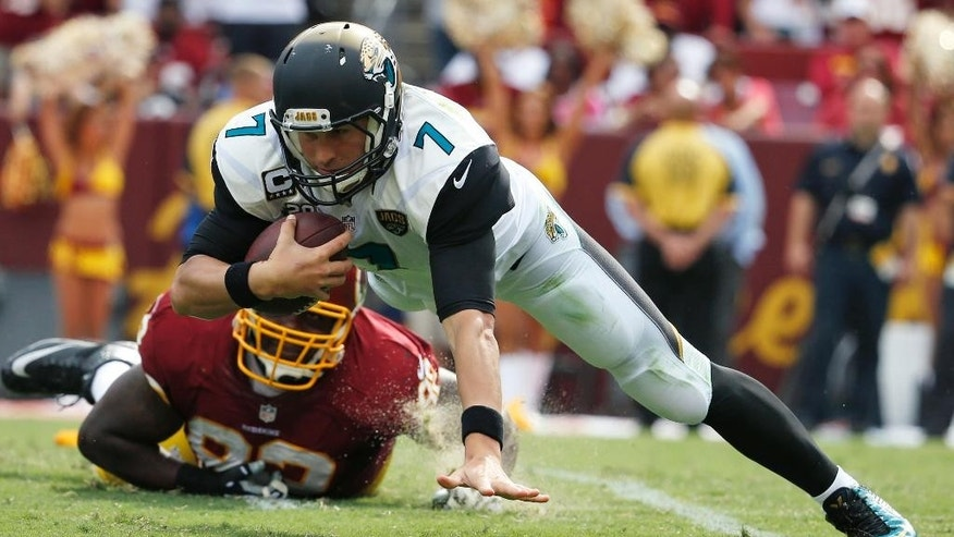 Jacksonville Jaguars quarterback Chad Henne (7) is sacked by Washington Redskins defensive end Chris Baker (92) during the second half of an NFL football game Sunday, Sept. 14, 2014, in Landover, Md. The Redskins won 41-10. (AP Photo/Evan Vucci)