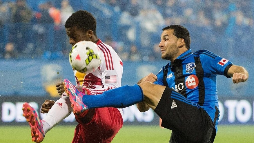 Montreal Impact's Dilly Duka, right, and New York Red Bulls' Marius Obekop battle for the ball during the first half of a CONCACAF Champions League soccer game, Wednesday, Sept. 17, 2014  in Montreal, (AP Photo/The Canadian Press, Graham Hughes)