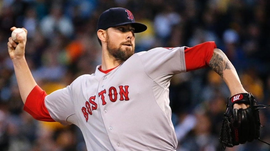 Boston Red Sox starting pitcher Anthony Ranaudo delivers during the first inning of a baseball game against the Pittsburgh Pirates in Pittsburgh Tuesday, Sept. 16, 2014. (AP Photo/Gene J. Puskar)