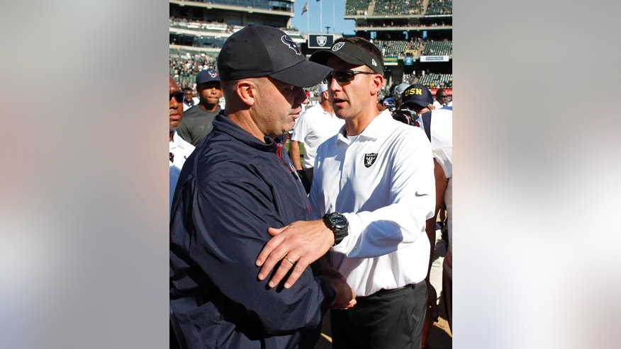 Houston Texans head coach Bill O'Brien, left, and Oakland Raiders head coach Dennis Allen, right, greet each other at the end of an NFL football game Sunday, Sept. 14, 2014, in Oakland, Calif. Houston won the game 30-14. (AP Photo/Beck Diefenbach)