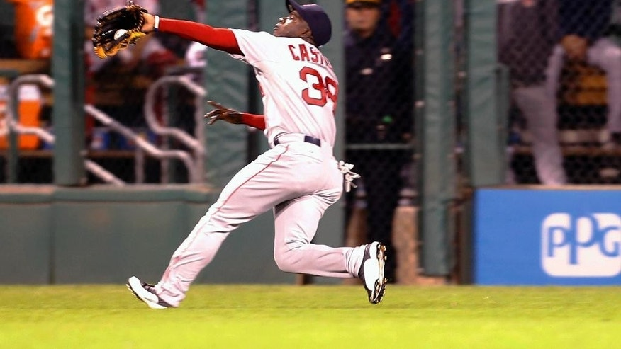 Boston Red Sox center fielder Rusney Castillo makes a catch of a fly ball by Pittsburgh Pirates starting pitcher Francisco Liriano in the fifth inning of the baseball game on Wednesday, Sept. 17, 2014, in Pittsburgh.  (AP Photo/Keith Srakocic)