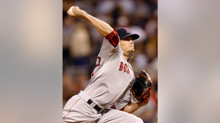 Boston Red Sox starting pitcher Clay Buchholz throws against the Pittsburgh Pirates in the first inning of a baseball game on Wednesday, Sept. 17, 2014, in Pittsburgh. (AP Photo/Keith Srakocic)