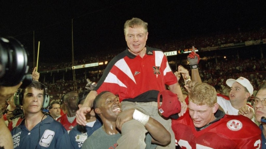 FILE - In this Jan. 1, 1995, file photo, Nebraska players carry coach Tom Osborne off the field after the Huskers defeated Miami 24-17 in the Orange Bowl NCAA college football game in Miami. The Miami and Nebraska programs are but a shell of their former selves as they enter Saturday night's game in Lincoln. (AP Photo/Doug Mills, File)