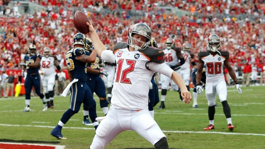 Tampa Bay Buccaneers quarterback Josh McCown (12) spikes the football after scoring on a 5-yard touchdown run against the St. Louis Rams during the first quarter of an NFL football game Sunday, Sept. 14, 2014, in Tampa, Fla. (AP Photo/Brian Blanco)