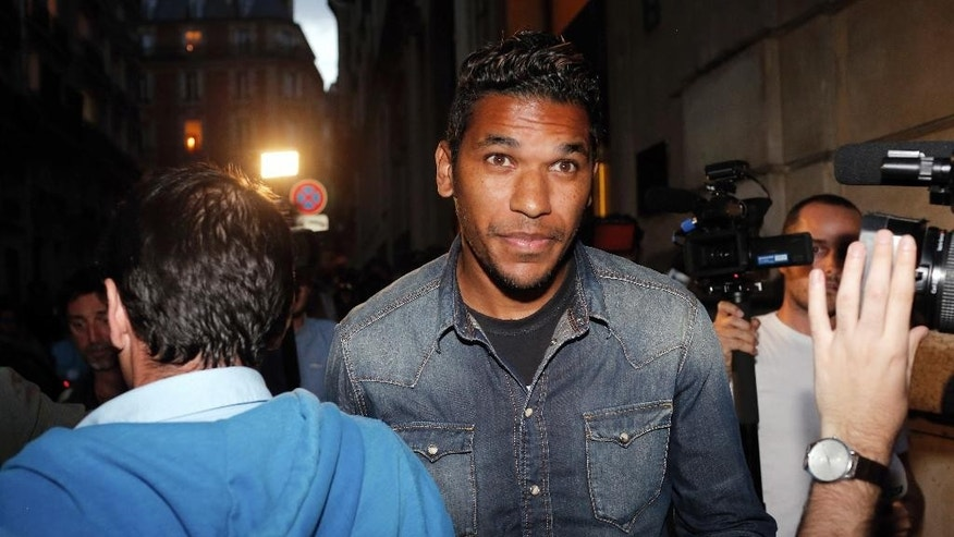 Brazilian striker Brandao leaves the French league disciplinary hearing, in Paris, Thursday, Sept. 18, 2014. Brandao attends a French league disciplinary hearing for headbutting Paris Saint-Germain midfielder Thiago Motta and breaking his nose after a match between PSG and Bastia last month. He has already been provisionally suspended but could face a lengthy ban. (AP Photo/Thibault Camus)