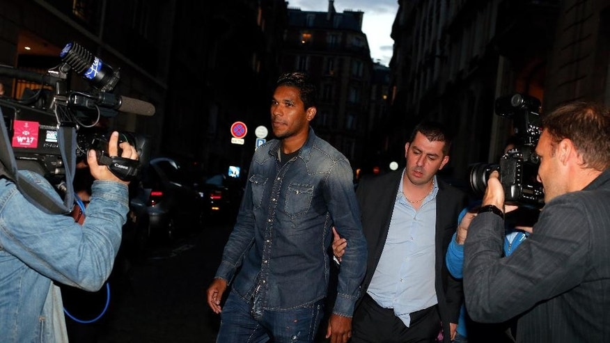 Brazilian striker Brandao, center, leaves the French league disciplinary hearing, in Paris, Thursday, Sept. 18, 2014. Brandao attended a French league disciplinary hearing for head butting Paris Saint-Germain midfielder Thiago Motta and breaking his nose after a match between PSG and Bastia last month. He has already been provisionally suspended but could face a lengthy ban. (AP Photo/Thibault Camus)
