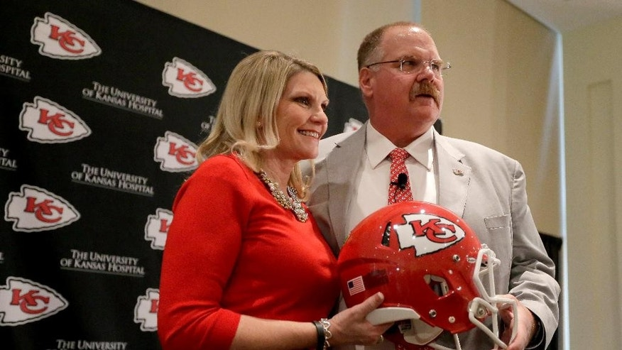 FILE - In this Jan. 7, 2013, file photo, Kansas City Chiefs head football coach Andy Reid, right, and his wife Tammy Reid pose for photographers during a news conference at Arrowhead Stadium in Kansas City, Mo. Now in Kansas City, Reid remains committed to the Laurel House, an organizations that helps victims of domestic violence, an issue that has turned the NFL on it head. (AP Photo/Charlie Riedel, File)
