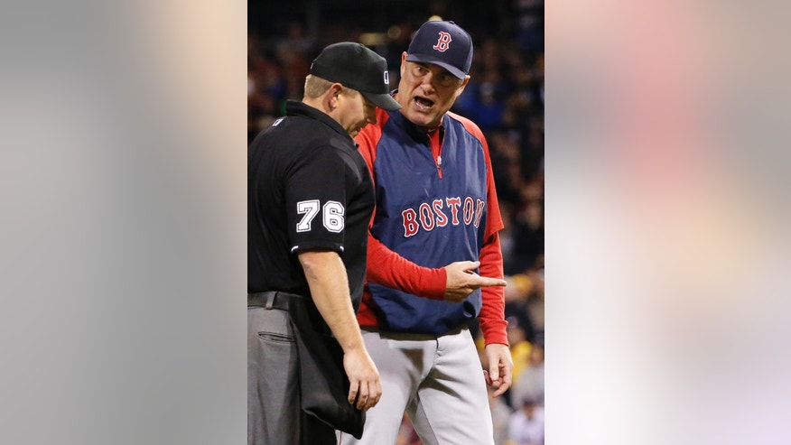Boston Red Sox manager John Farrell, right argues a call at third base with home plate umpire Mike Muchlinski (76) during the ninth inning of a baseball game against the Pittsburgh Pirates in Pittsburgh Thursday, Sept. 18, 2014. Boston base runner Jemile Weeks, who was leading off third, was hit by a ground ball down the third baseline by Will Middlebrooks, and was called out. The Pirates won 3-2. (AP Photo/Gene J. Puskar)