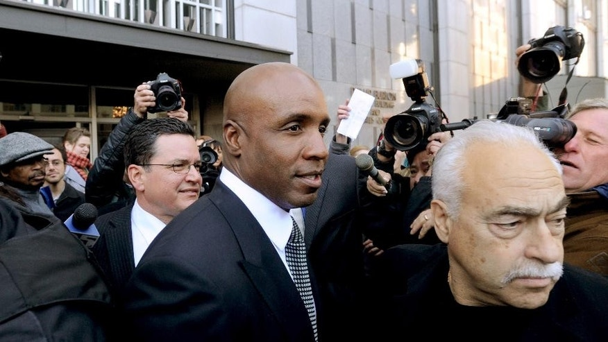 File - In this Dec. 16, 2011 file photo, former baseball player Barry Bonds leaves federal court after being sentenced for obstructing justice in a government steroids investigation in San Francisco. Nearly 11 years after Bonds testified before a grand jury investigating the illegal distribution of performance-enhancing drugs, a group of judges will hear arguments Thursday, Sept. 18, 2014, on whether baseball's career home-run leader should have his obstruction of justice conviction thrown out. (AP Photo/Noah Berger, File)