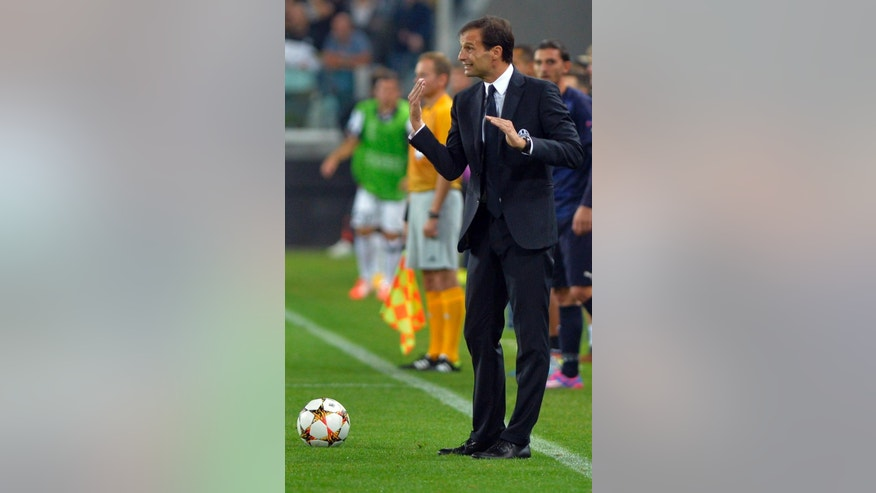 Juventus coach Massimiliano Allegri gestures  during a Champions League, Group A soccer match between Juventus and Malmo, at the Juventus Stadium in Turin, Italy, Tuesday, Sept. 16, 2014. (AP Photo/Massimo Pinca)
