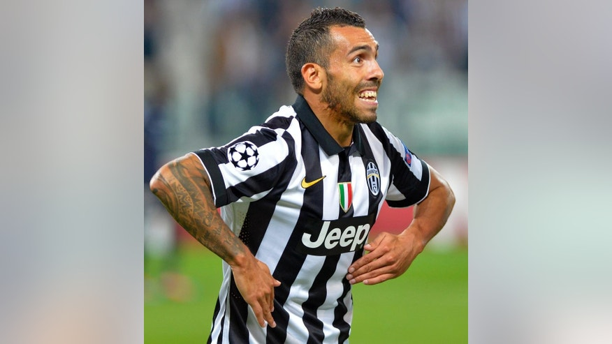 Juventus' Carlos Tevez celebrates after scoring his side's first goal during a Champions League, Group A soccer match between Juventus and Malmo, at the Juventus Stadium in Turin, Italy, Tuesday, Sept. 16, 2014. (AP Photo/Massimo Pinca)