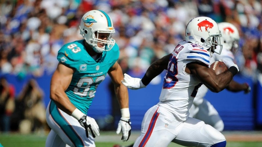 Buffalo Bills running back C.J. Spiller, right, runs past Miami Dolphins outside linebacker Jason Trusnik (93) during the second half of an NFL football game Sunday, Sept. 14, 2014, in Orchard Park, N.Y. Buffalo won 29-10. (AP Photo/Gary Wiepert)