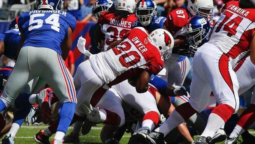 Sept. 14, 2014: Arizona Cardinals running back Jonathan Dwyer (20) rushes for a touchdown during the first half of an NFL football game against the New York Giants in East Rutherford, N.J.