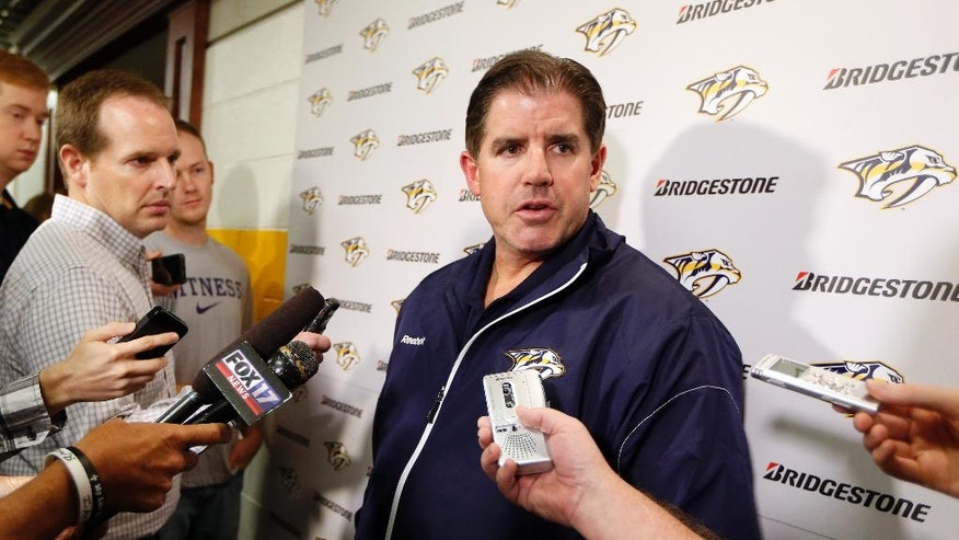 Nashville Predators head coach Peter Laviolette talks with reporters on the first day of NHL hockey training camp Thursday, Sept. 18, 2014, in Nashville, Tenn. The Predators officially kick off a new era Thursday, reporting for training camp with Laviolette and four new players they hope will bulk up Nashville's offensive output. (AP Photo/Mark Humphrey)