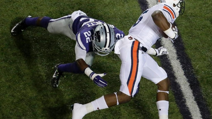 Auburn wide receiver Ricardo Louis (5) gets past Kansas State defensive back Dante Barnett (22) to score a touchdown during the first half of an NCAA college football game Thursday, Sept. 18, 2014, in Manhattan, Kan. (AP Photo/Charlie Riedel)
