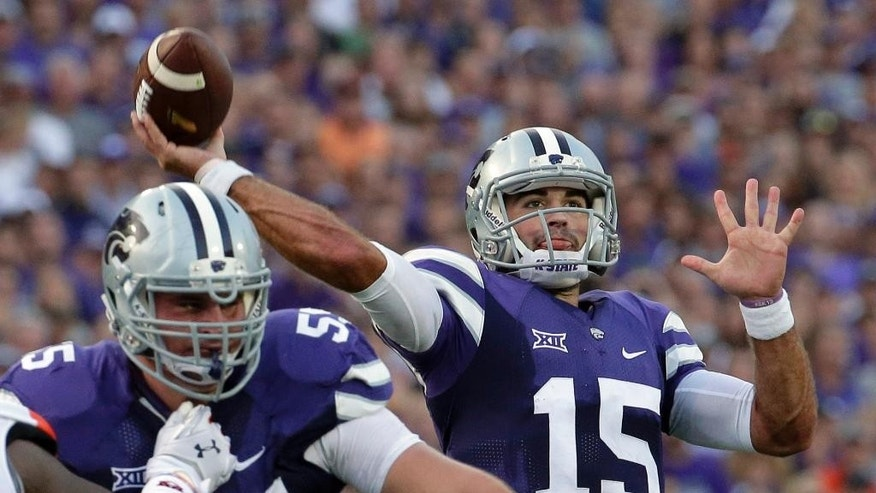 Kansas State quarterback Jake Waters (15) passes the ball during the first half of an NCAA college football game against Auburn, Thursday, Sept. 18, 2014, in Manhattan, Kan. (AP Photo/Charlie Riedel)