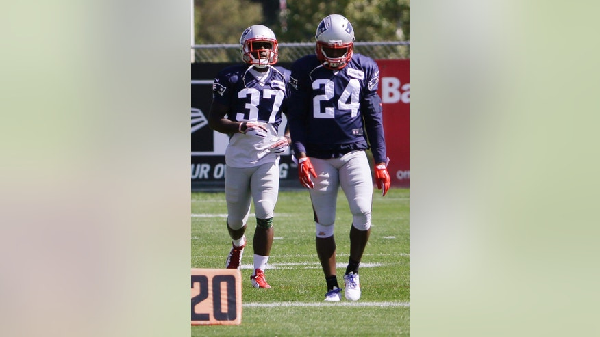 New England Patriots cornerbacks Darrelle Revis (24) and Alfonzo Dennard (37) walk during a stretching session before practice begins at the NFL football team's facility Wednesday, Sept. 17, 2014 in Foxborough, Mass. (AP Photo/Stephan Savoia)