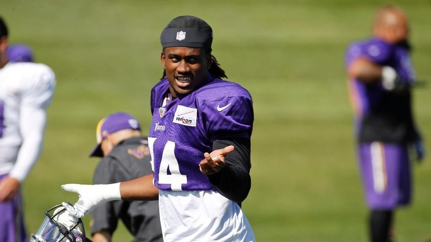 Minnesota Vikings wide receiver Cordarrelle Patterson talks with a teammate during NFL football practice at Winter Park in Eden Prairie, Minn., Wednesday, Sept. 17, 2014. (AP Photo/Ann Heisenfelt)