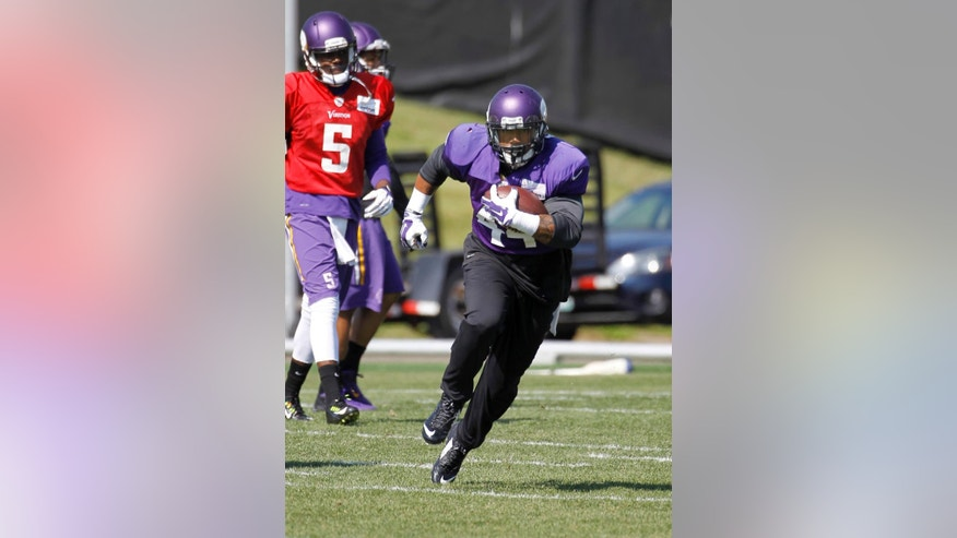 Minnesota Vikings running back Matt Asiata carries the ball during NFL football practice at Winter Park in Eden Prairie, Minn., Wednesday, Sept. 17, 2014. (AP Photo/Ann Heisenfelt)