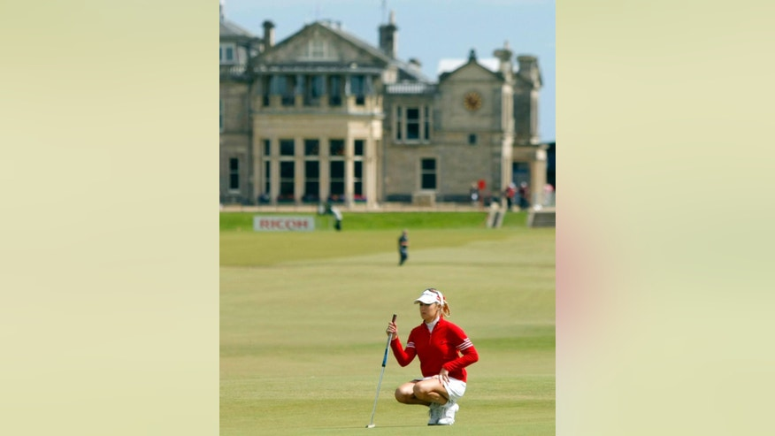 FILE- In this Aug. 4, 2007, file photo, Natalie Gulbis of the United States, lines up a putt on the 17th green during the Women's British Open golf tournament on the Old Course at the Royal and Ancient Golf Club in St Andrews, Scotland.  The Royal & Ancient Golf Club at St. Andrews has voted  overwhelmingly Thursday, Sept. 18, 2014, to admit female members for the first time. (AP Photo/Matt Dunham, File)
